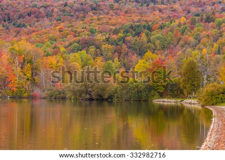 Autumn foliage and reflection in Vermont. - stock photo