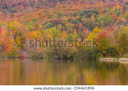 Autumn foliage and reflection in Vermont, Elmore state park. - stock photo