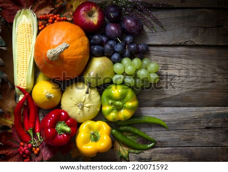 Autumn fruits and vegetables on vintage boards - stock photo