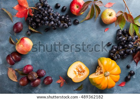 Autumn fruits and vegetables on wooden background, selective focus, autumn nature concept