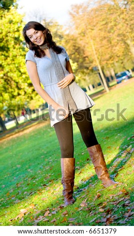 autumn girl portrait outdoors in a park - full body - stock photo
