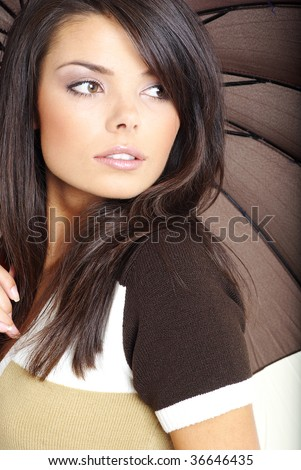 autumn girl with brown umbrella - stock photo