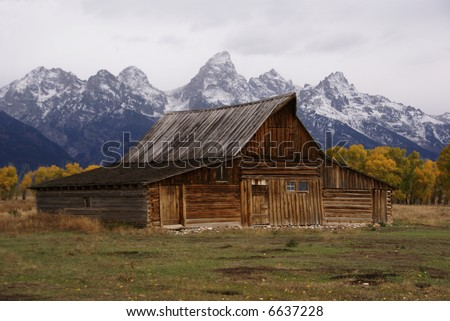 Autumn, Grand Tetons and old western farm buildings	Mormon Row,	Grand Teton National Park,	Wyoming