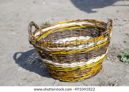 Autumn hike in the woods. Wicker brown empty basket