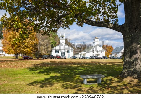 Autumn in New England. Few of the Guildhall church and Essex County Courthouse, surrounded by trees with fall foliage in the small town of Guildhall, Vermont, USA - stock photo