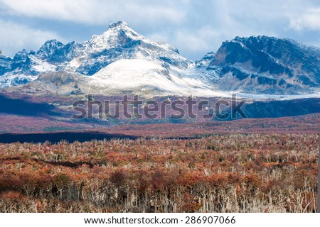 Autumn in Patagonia. Cordillera Darwin, part of Andes range, Isla Grande de Tierra del Fuego, Chilean territory, view from the Argentina side - stock photo