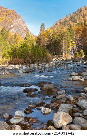 Autumn in the mountains. Fast mountain river - stock photo