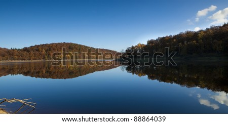 Autumn is falling at a lake - stock photo
