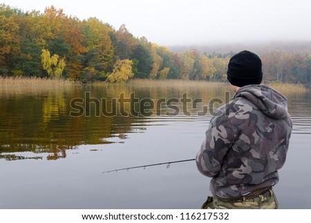 Autumn lake fishing - stock photo