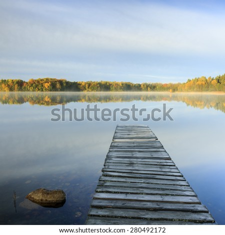 Autumn Lake Forest Reflections With Wooden Pier In North Poland/ Sunrise Lake At Autumn - stock photo