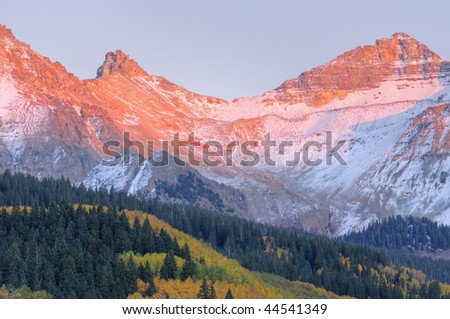 Autumn landscape at sunset, San Juan Mountains with conifers and aspens, Colorado, USA - stock photo