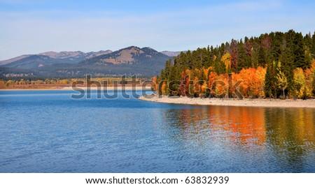 Autumn landscape in Grand Tetons national park near Jackson lake - stock photo
