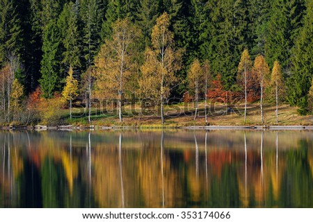 Autumn Landscape. Mountains in Autumn. The bright colors of autumn in the park by the lake. - stock photo