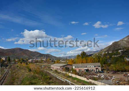 Autumn landscape with dramatic clouds - stock photo