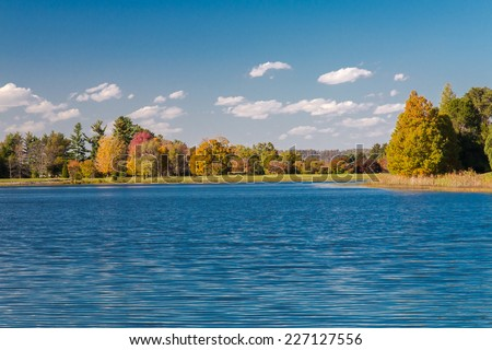 Autumn landscape with lake and forest - stock photo