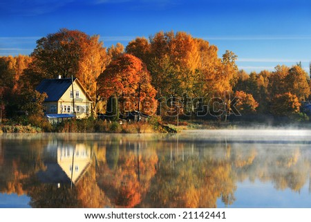 Autumn Landscape with Lake and yellowed trees - stock photo