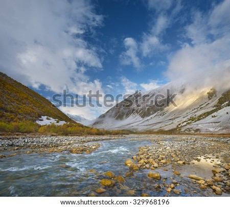 Autumn landscape with the first snow. River in the mountains. Valley Enguri river. Caucasus. Zemo Svaneti, Georgia - stock photo