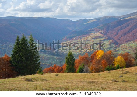 Autumn landscape with woods on the slopes. Mountain Village. Carpathians, Ukraine, Europe - stock photo