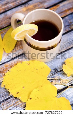 Autumn leafs with cup of tea.