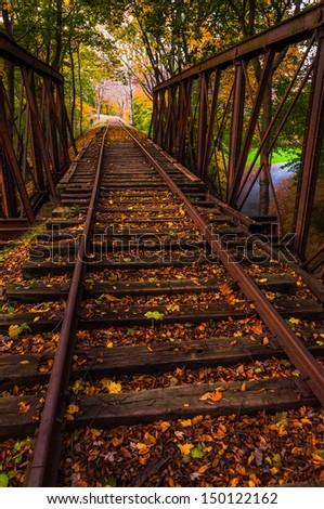 Autumn leaves on a railroad bridge in York County, Pennsylvania. - stock photo