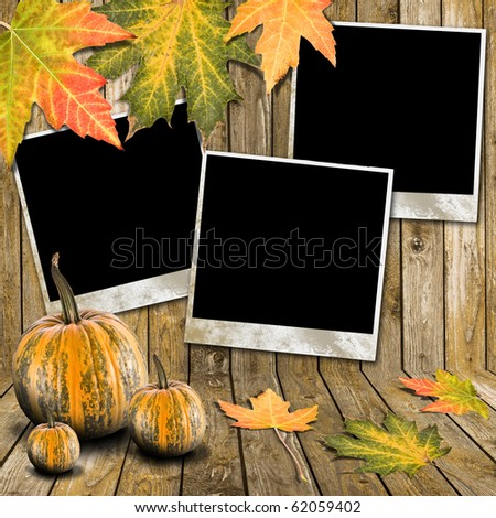 Autumn Leaves, pumpkin and photo frame over wooden background - stock photo
