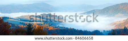 Autumn misty morning mountain panorama (Carpathian , Ukraine). Three shots stitch image. - stock photo
