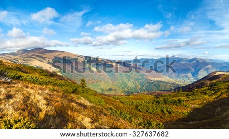 Autumn misty mountain panorama (Carpathian Mt's, Ukraine). Three shots stitch image. - stock photo