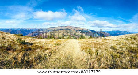 Autumn misty mountain panorama with country road (Carpathian Mt's, Ukraine). Four shots stitch image. - stock photo