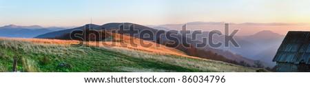 Autumn misty sunset mountain panorama (Carpathian Mt's, Ukraine). Four shots stitch image. - stock photo