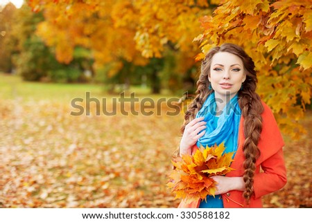 Autumn model, bright make up. woman on background fall landscape leaves of trees. Girl Model on autumn season. Fashion people.