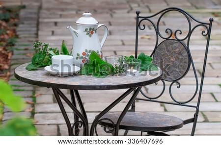 Autumn mood with iron garden furniture - stock photo