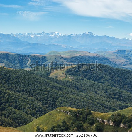 autumn mountain landscape green forest and blue sky