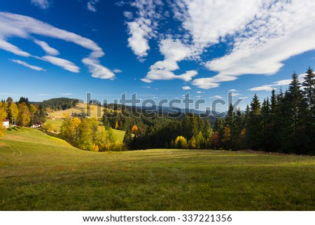 Autumn mountain landscape with blue sky and clouds - Moravian-Silesian Beskydy - stock photo