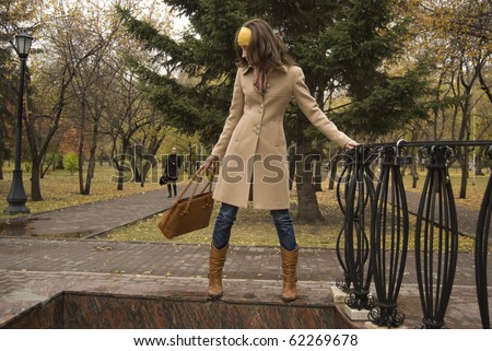 Autumn nature. Portrait of young attractive woman outdoor at park - stock photo