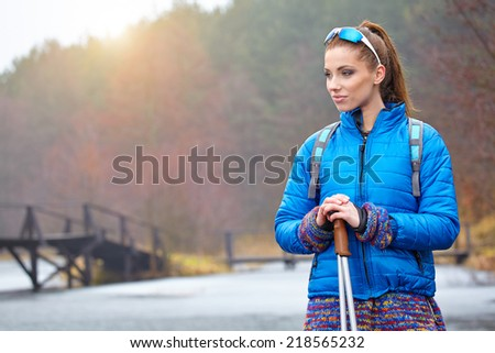 Autumn Nordic walking - active woman exercising outdoor  - stock photo
