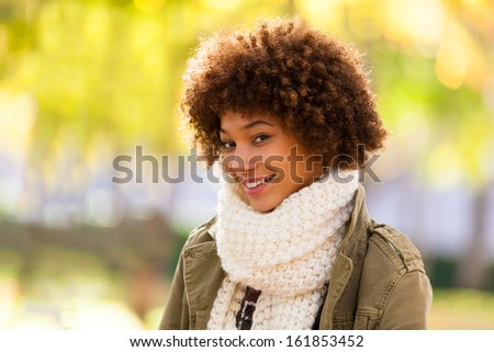 Autumn outdoor portrait of beautiful African American young woman - Black people - stock photo