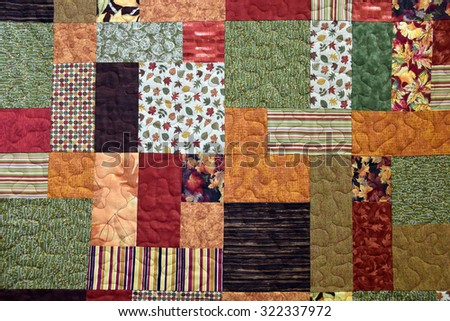 autumn patchwork quilt background - stock photo