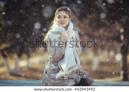 Autumn portrait of a girl in a coat