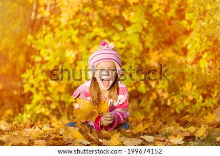 Autumn portrait of a  laughing little  girl - stock photo