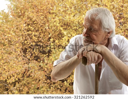 Autumn. Portrait of a senior man thinking about something - stock photo