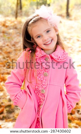 Autumn portrait of adorable little girl - stock photo