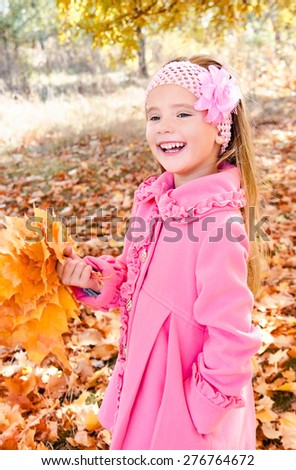 Autumn portrait of adorable little girl with maple leaves outdoor - stock photo