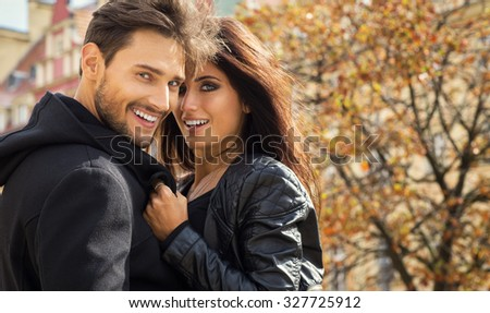 Autumn portrait of happy couple - stock photo