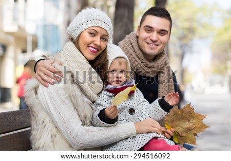 Autumn portrait of happy parents with children. Shallow focus 