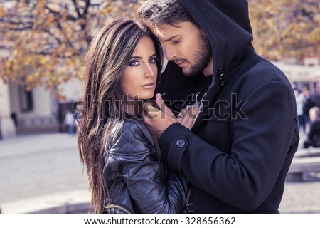 Autumn portrait of sexy couple - stock photo