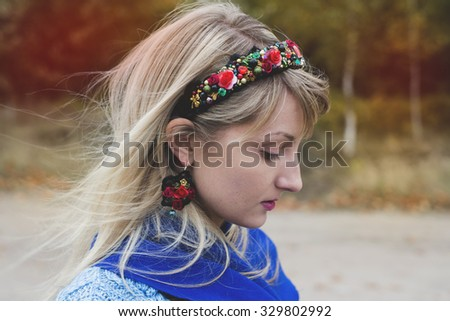 Autumn portrait of the woman in a headband and the Spanish earrings - stock photo