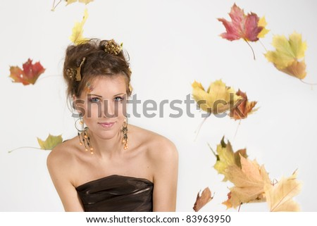 autumn portrait of woman and falling maple leaves