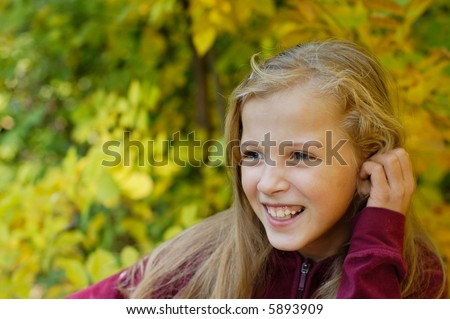 autumn portrait of young girl - stock photo