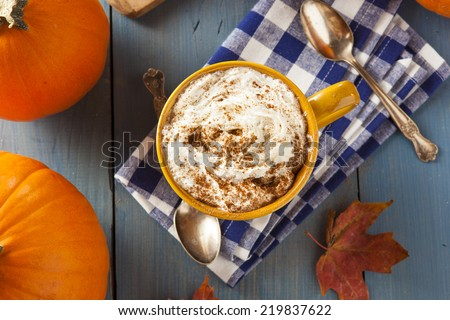 Autumn Pumpkin Spice Latte with Milk and Cream - stock photo
