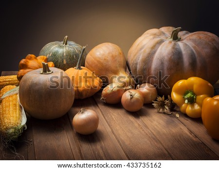 autumn pumpkins and other fruits  vegetables on a wooden table - stock photo